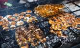 cooking-bbq-seafood-background-fire-grilled-fresh-prawns-fish-octopus-oysters-food-barbecue-indonesia-71634966